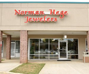 Norman Hege Jewelers | The front of Norman Hege Jewelers' building showing their sign and front glass doors
