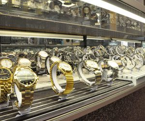 Norman Hege Jewelers | Glass display case showcasing a various selection of fine watches in gold and silver