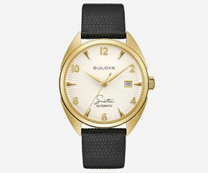 Norman Hege Jewelers | Gold Bulova watch with a leather band against a white background